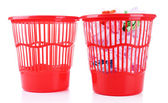 Full and empty garbage bins, isolated on white — Stock Photo