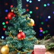 Stock Photo: Decorative Christmas tree with gifts on table on bright background