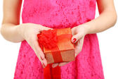 Young woman holding gift in hands close up — Stock Photo
