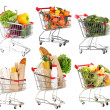 Trolleys with different products isolated on white — Stock Photo