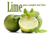 Fresh lime with mint isolated on white — Foto de Stock