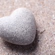 Stock Photo: Grey stone in shape of heart, on wooden background