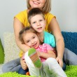 Stock Photo: Little children with mom in room