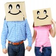Couple with cardboard boxes on their heads isolated on white — Stock Photo