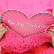 Stock Photo: Young womread Valentine card close up