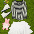 Stockfoto: Beautiful clothes for little girl on green carpet