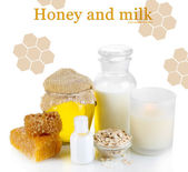 Honey and milk spa with oils and honey isolated on white — Stock Photo