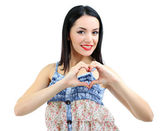 Attractive young woman with heart isolated on white — Stock Photo