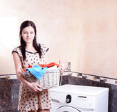 Beautiful young woman erases in house — Stock Photo