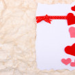 Beautiful romantic background with decorative hearts — Stock Photo