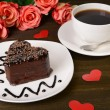 Stock Photo: Sweet cake with chocolate on plate on table close-up