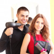 Young man and woman hairdressers in beauty salon — Stock Photo #40592747