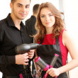 Young man and woman hairdressers in beauty salon — Stock Photo #40592761