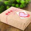 Paper gift box on wooden background — Stock Photo #40593977