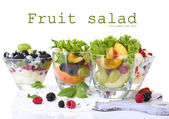 Fruit salad in glasses, isolated on white — Foto de Stock