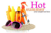 Bottles with suntan cream and sunglasses, isolated on white — Stock Photo