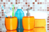 Cosmetics and bath accessories on mosaic tiles background — Стоковое фото