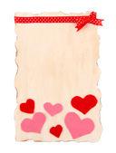 Mooie vel papier met decoratieve harten, geïsoleerd op wit — Stockfoto