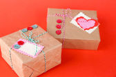 Paper gift boxes on color background — Photo