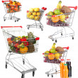 Trolleys with different fruits and vegetables isolated on white — Stock Photo #40638937