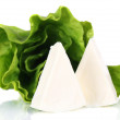 图库照片: Cream cheese with greens isolated on white