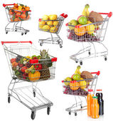 Trolleys with different fruits and vegetables isolated on white — Stock Photo