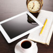 Stock Photo: Tablet, newspaper, cup of coffee and alarm clock on wooden table