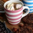 Stock Photo: Cup of cappuccino and sweets close up