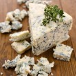 Stock Photo: Tasty blue cheese with thyme, on wooden table
