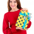 Stock Photo: Attractive womwith gift box, isolated on white