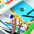 Stock Photo: School supplies in open desk drawer close up