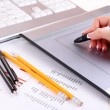 Stock Photo: Female hand using graphics tablet on table close up