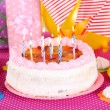 Festive cake on table for birthday on celebratory decorations — Stock Photo #40643071