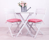 Garden chairs and table with flowers on white background — Stock Photo