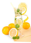Glass of cocktail with lemon and mint isolated on white — Stock Photo