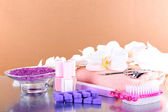 Pedicure set on table on beige background — Stock Photo