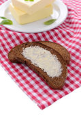 Slice of rye bread with butter, isolated on white — Stock Photo