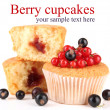 Tasty muffins with berries isolated on white — Stock Photo #40716467