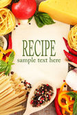 Paper for recipes, spaghetti with vegetables and spices, on sacking background — Stock Photo