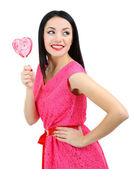 Attractive young woman with heart lollipop isolated on white — Stock Photo