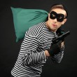 Stock Photo: Thief with bag isolated on black