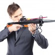 Young businessman with crossbow, isolated on white — Stock Photo