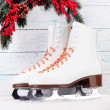 Figure skates on wooden background — Stock Photo #40784699