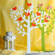 Decorative tree with decorative hearts, on wooden table on color fabric background — Stock Photo