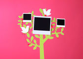 Holder in form of tree with instant photo cards on dark color background — Stok fotoğraf