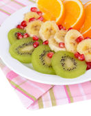 Sweet fresh fruits on plate on table close-up — Foto de Stock