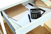 Office supplies in open desk drawer close up — Stock Photo