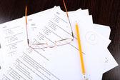 Grade written on an exam paper, close-up — Stock Photo