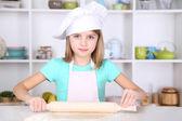 Little girl preparing cake dough in kitchen at home — ストック写真