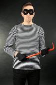 Thief on dark background — Stock Photo